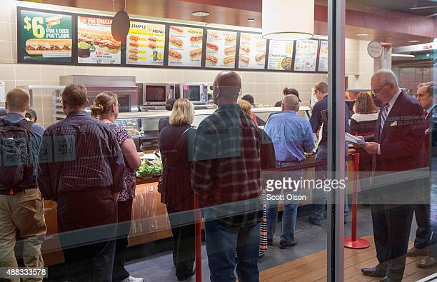 Diners wait in line at a Subway sandwich shop at a food court in a downtown office building on September 15 2015 in Chicago Illinois Sales at retail...