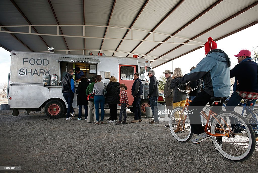 Diners wait to order food from the Food Shark food truck on Highland Avenue December 26, 2012 in Marfa, Texas. Situated in West Texas, this town of just over 2000 residents has become a popular tourist destination.