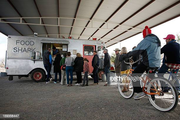 Diners wait to order food from the Food Shark food truck on Highland Avenue December 26 2012 in Marfa Texas Situated in West Texas this town of just...