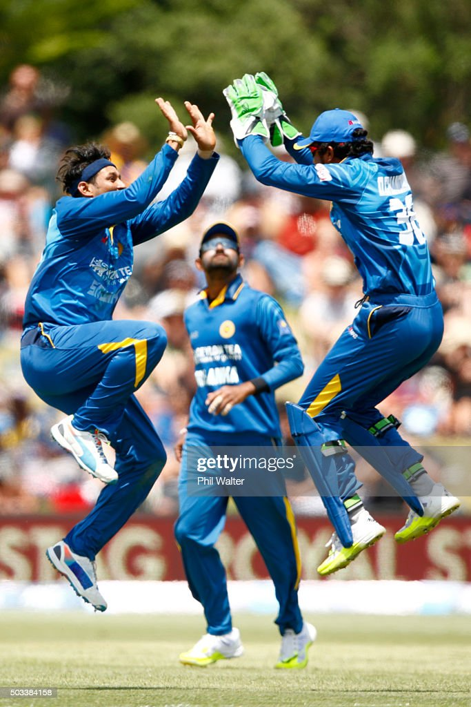 <a gi-track='captionPersonalityLinkClicked' href=/galleries/search?phrase=Dinesh+Chandimal&family=editorial&specificpeople=4884949 ng-click='$event.stopPropagation()'>Dinesh Chandimal</a> (R) and <a gi-track='captionPersonalityLinkClicked' href=/galleries/search?phrase=Tillakaratne+Dilshan&family=editorial&specificpeople=239186 ng-click='$event.stopPropagation()'>Tillakaratne Dilshan</a> (L) of Sri Lanka celebrate their wicket of Kane Williamson of New Zealand during game five of the One Day International series between New Zealand and Sri Lanka at Bay Oval on January 5, 2016 in Mount Maunganui, New Zealand.