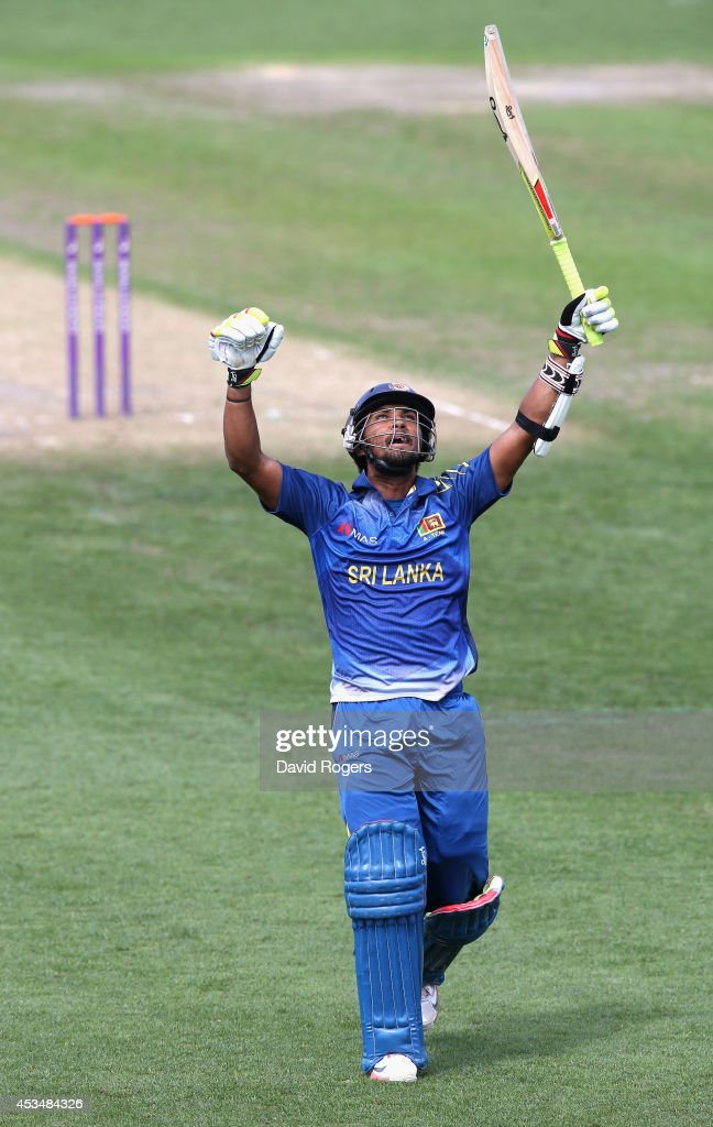 <a gi-track='captionPersonalityLinkClicked' href=/galleries/search?phrase=Dinesh+Chandimal&family=editorial&specificpeople=4884949 ng-click='$event.stopPropagation()'>Dinesh Chandimal</a> of Sri Lanka A celebrates after scoring a centrury during the Triangular Series match between England Lions and Sri Lanka A at New Road on August 11, 2014 in Worcester, England.