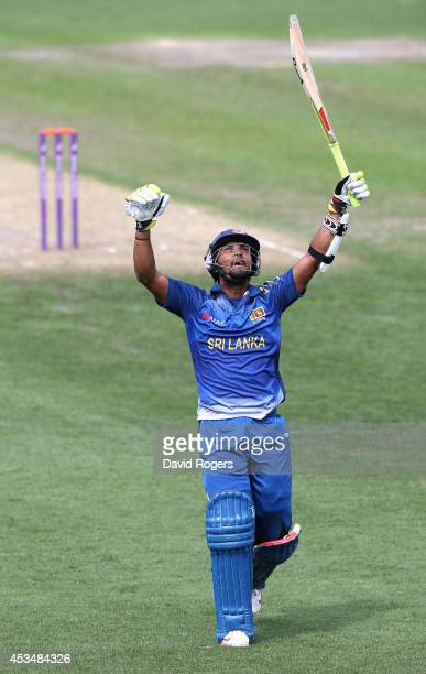Dinesh Chandimal of Sri Lanka A celebrates after scoring a centrury during the Triangular Series match between England Lions and Sri Lanka A at New...