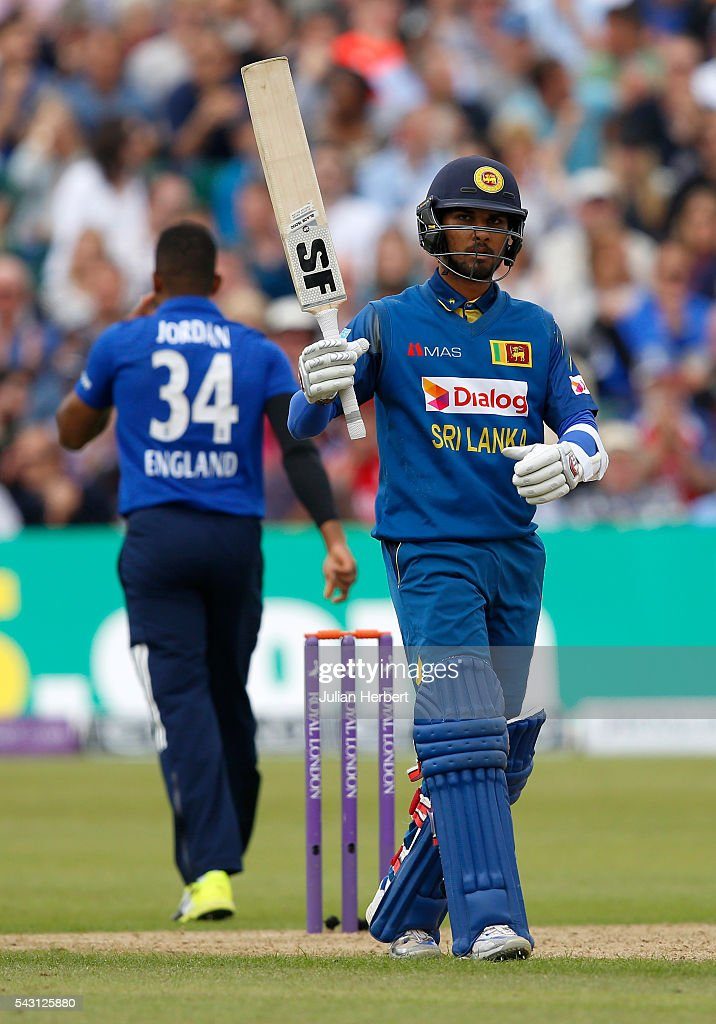 Dinesh Chandimal of Sri Lanka acknowledges his half century during The 3rd ODI Royal London One-Day match between England and Sri Lanka at The County Ground on June 26, 2016 in Bristol, England.