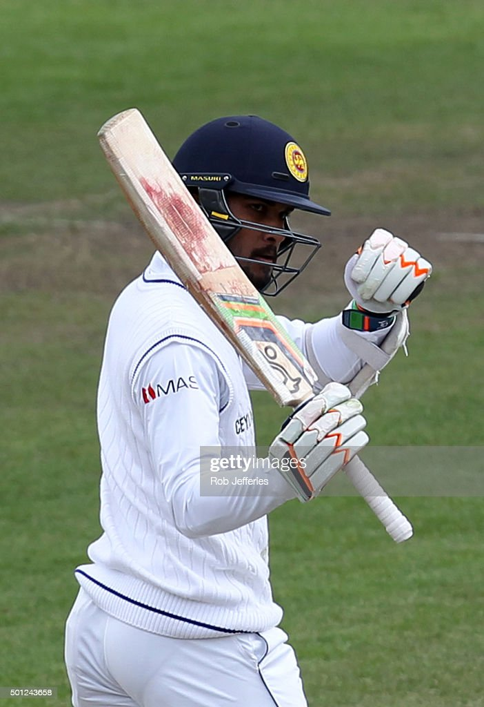 Dinesh Chandimal of Sri Lanka acknowledges his teammates after scoring 50 runs during day five of the First Test match between New Zealand and Sri...