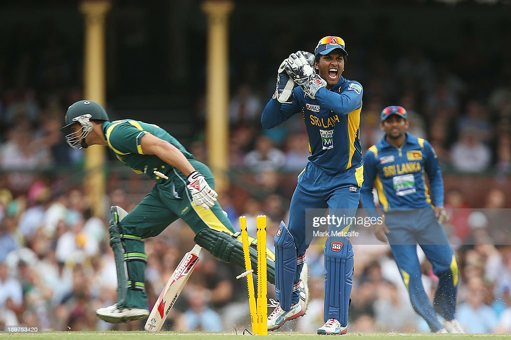 Dinesh Chandimal of Sri Lanka appeals for the runout of Mitchell Johnson of Australia during game four of the Commonwealth Bank one day international series between Australia and Sri Lanka at Sydney Cricket Ground on January 20, 2013 in Sydney, Australia.