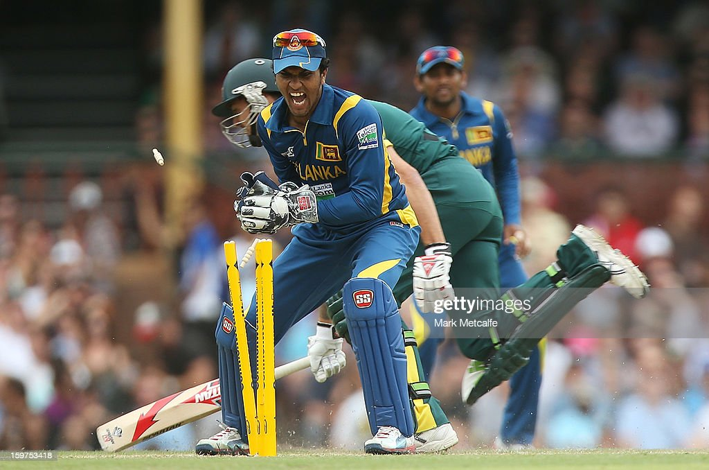 Dinesh Chandimal of Sri Lanka attempts to runout Mitchell Johnson of Australia during game four of the Commonwealth Bank one day international series between Australia and Sri Lanka at Sydney Cricket Ground on January 20, 2013 in Sydney, Australia.