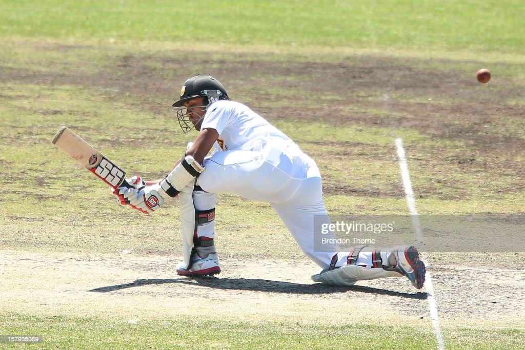 <a gi-track='captionPersonalityLinkClicked' href=/galleries/search?phrase=Dinesh+Chandimal&family=editorial&specificpeople=4884949 ng-click='$event.stopPropagation()'>Dinesh Chandimal</a> of Sri Lanka bats during day three of the international tour match between the Chairman's XI and Sri Lanka at Manuka Oval on December 8, 2012 in Canberra, Australia.