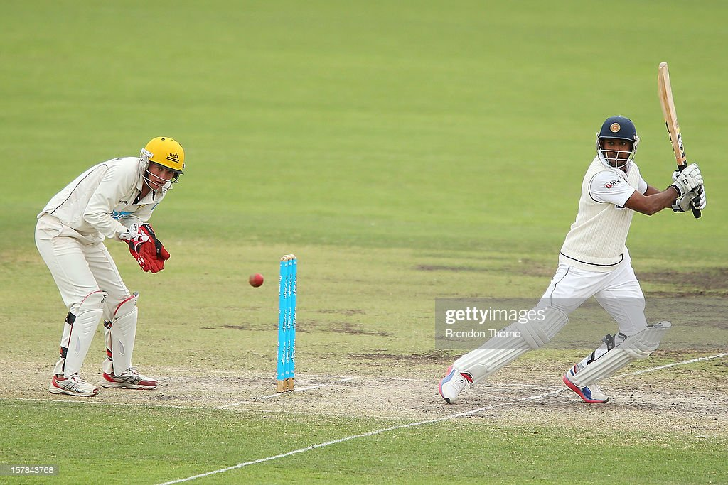 <a gi-track='captionPersonalityLinkClicked' href=/galleries/search?phrase=Dinesh+Chandimal&family=editorial&specificpeople=4884949 ng-click='$event.stopPropagation()'>Dinesh Chandimal</a> of Sri Lanka bats during day two of the international tour match between the Chairman's XI and Sri Lanka at Manuka Oval on December 7, 2012 in Canberra, Australia.