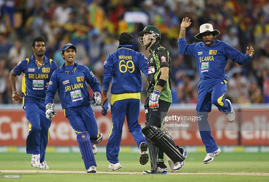 <a gi-track='captionPersonalityLinkClicked' href=/galleries/search?phrase=Dinesh+Chandimal&family=editorial&specificpeople=4884949 ng-click='$event.stopPropagation()'>Dinesh Chandimal</a> of Sri Lanka celebrates as <a gi-track='captionPersonalityLinkClicked' href=/galleries/search?phrase=Glenn+Maxwell&family=editorial&specificpeople=752174 ng-click='$event.stopPropagation()'>Glenn Maxwell</a> (2nd R) of Australia walks from the field after the final ball of the game during game two of the Twenty20 International series between Australia and Sri Lanka at the Melbourne Cricket Ground on January 28, 2013 in Melbourne, Australia.