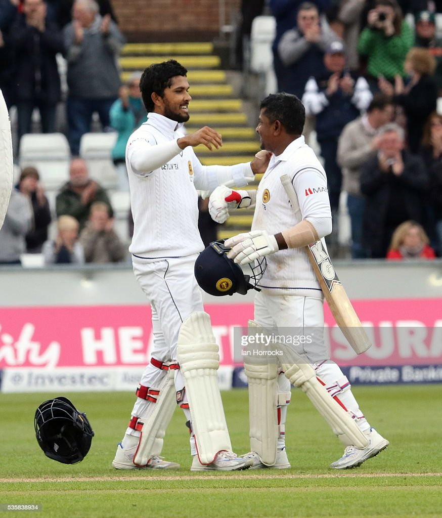 Dinesh Chandimal of Sri Lanka (L) celebrates scoring 100 with batting partner Rangana Herath during day four of the 2nd Investec Test match between England and Sri Lanka at Emirates Durham ICG on May 30, 2016 in Chester-le-Street, United Kingdom.