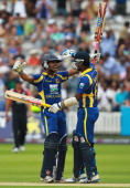 Dinesh Chandimal of Sri Lanka celebrates with Angelo Mathews as Sri Lanka win the 3rd Natwest One Day International Series match between England and...