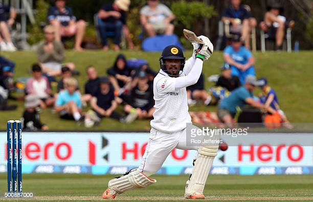 Dinesh Chandimal of Sri Lanka drives through the covers for 4 during day two of the First Test match between New Zealand and Sri Lanka at University...