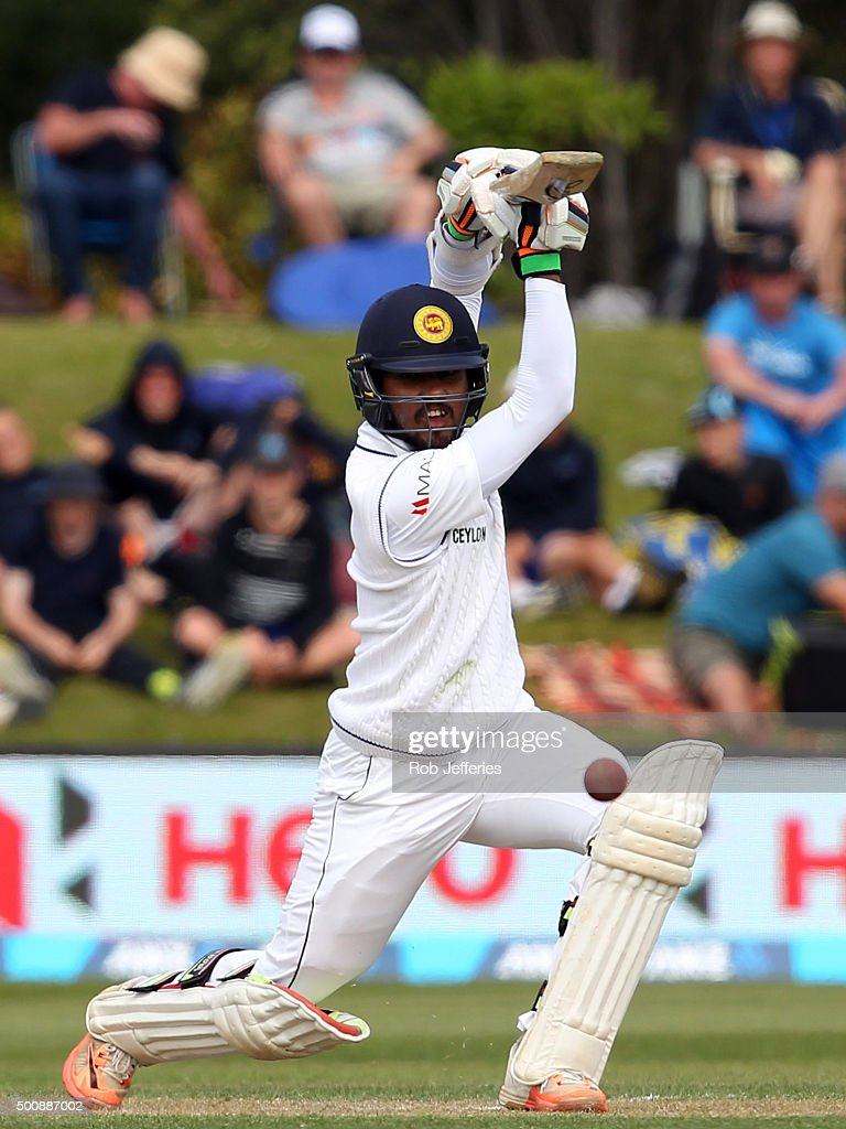 <a gi-track='captionPersonalityLinkClicked' href=/galleries/search?phrase=Dinesh+Chandimal&family=editorial&specificpeople=4884949 ng-click='$event.stopPropagation()'>Dinesh Chandimal</a> of Sri Lanka drives through the covers for 4 during day two of the First Test match between New Zealand and Sri Lanka at University Oval on December 11, 2015 in Dunedin, New Zealand.