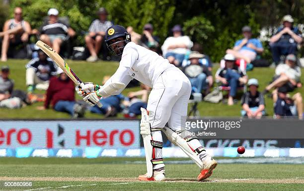 Dinesh Chandimal of Sri Lanka guides the ball through fineleg during day two of the First Test match between New Zealand and Sri Lanka at University...