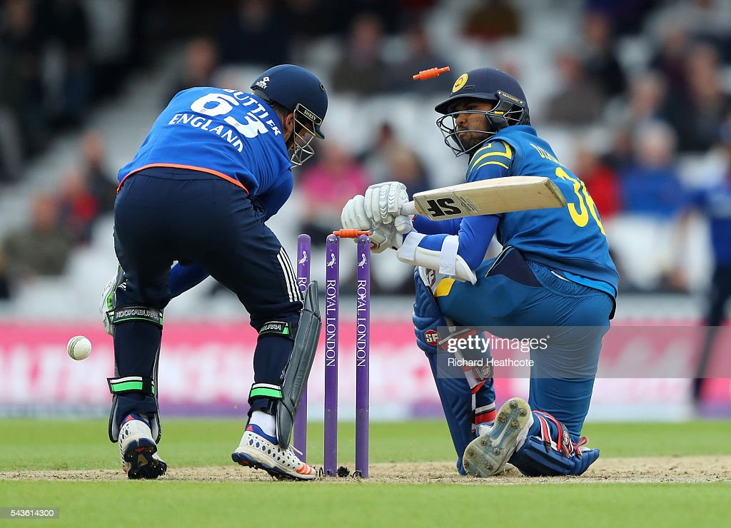 <a gi-track='captionPersonalityLinkClicked' href=/galleries/search?phrase=Dinesh+Chandimal&family=editorial&specificpeople=4884949 ng-click='$event.stopPropagation()'>Dinesh Chandimal</a> of Sri Lanka is bowled out by David Willey during the 4th Royal London ODI between England and Sri Lanka at The Kia Oval on June 29, 2016 in London, England.