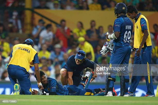 Dinesh Chandimal of Sri Lanka receives attention for an injury during the 2015 ICC Cricket World Cup match between Australia and Sri Lanka at Sydney...