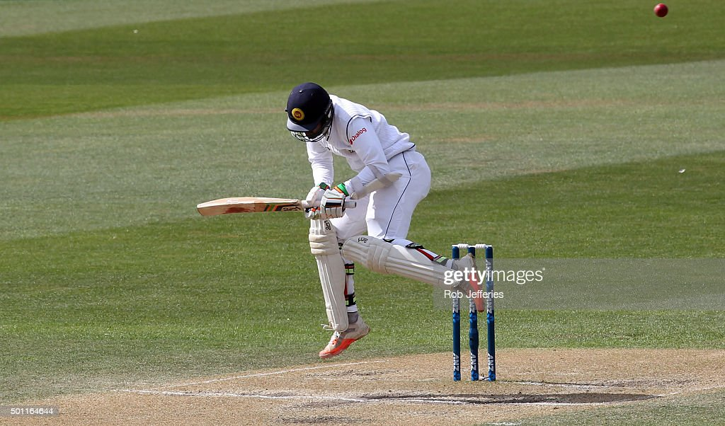 Dinesh Chandimal of Sri Lanka takes evasive action to a bouncer during day four of the First Test match between New Zealand and Sri Lanka at...