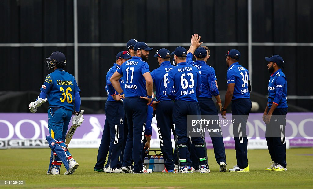 <a gi-track='captionPersonalityLinkClicked' href=/galleries/search?phrase=Dinesh+Chandimal&family=editorial&specificpeople=4884949 ng-click='$event.stopPropagation()'>Dinesh Chandimal</a> of Sri Lanka walks off past the celebrating England players after his dismissal during The 3rd ODI Royal London One-Day match between England and Sri Lanka at The County Ground on June 26, 2016 in Bristol, England.