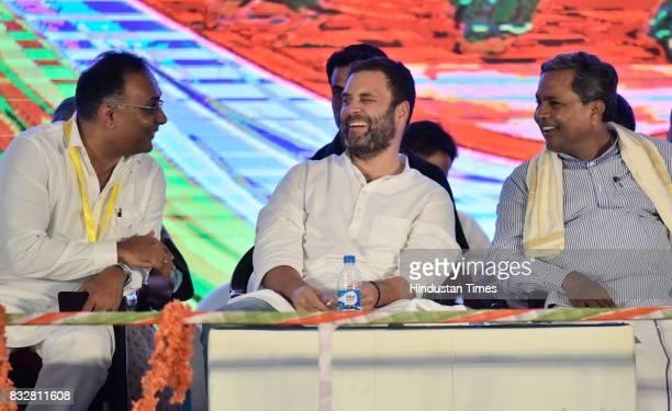 Dinesh Gundurao Congress Vice President Rahul Gandhi and Karnataka Chief Minister Siddaramaiah share a light moment during a public meeting at...