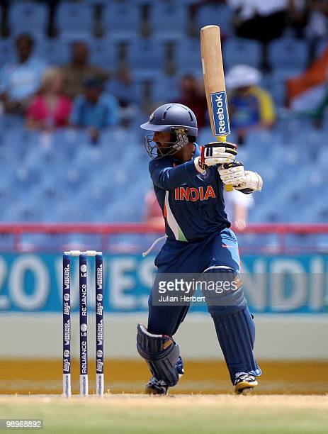 Dinesh Karhik of India scores runs during the ICC Super Eight match between India and Sri Lanka played at the Beausejour Cricket Ground on May 11...