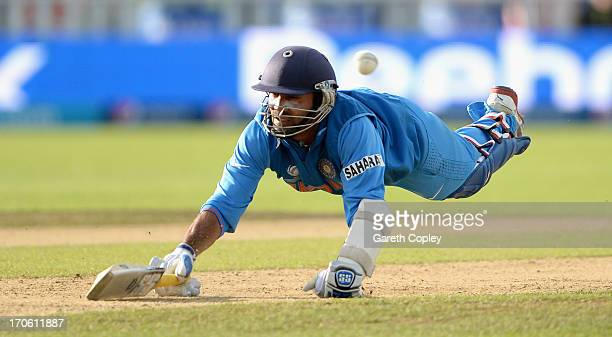 Dinesh Karthik of India dives into his crease during the ICC Champions Trophy match between India and Pakiatan at Edgbaston on June 15 2013 in...