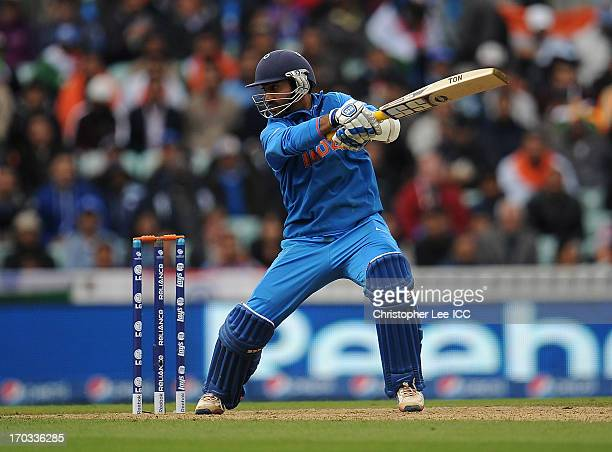 Dinesh Karthik of India in action during the ICC Champions Trophy Group B match between India and West Indies at The Oval on June 11 2013 in London...