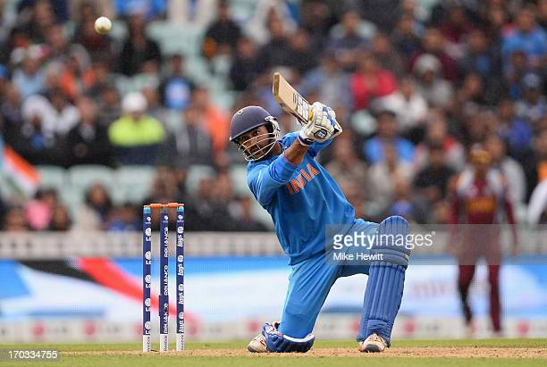 Dinesh Karthik of India smashes a boundary to reach his half centurynand win the match during the ICC Champions Trophy Group B match between India...
