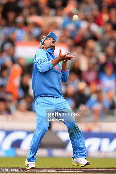 Dinesh Karthik of India takes a catch to dismiss Sunil Narine of West during the ICC Champions Trophy Group B match between India and West Indies at...