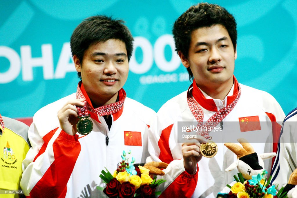 Ding Junhui and Tian Pengfei of China pose with their Gold Medals after the Men's Snooker Team match between China and Macau at the 15th Asian Games...