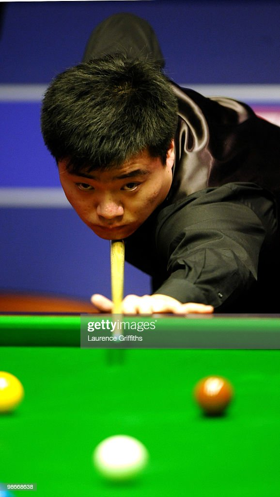 Ding Junhui in action in his match against Shaun Murphy during the Betfredcom World Snooker Championships at the Crucible Theatre on April 26 2010 in...
