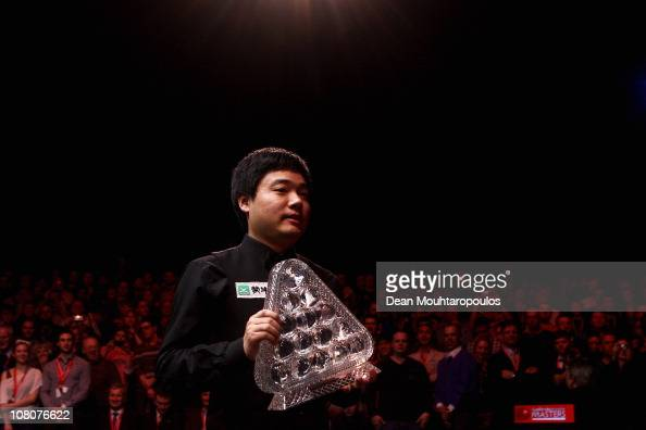 Ding Junhui of China celebrates with the Trophy after his victory against Marco Fu of Hong Kong in the Final of The Ladbrokesmobile Masters on Day 8...