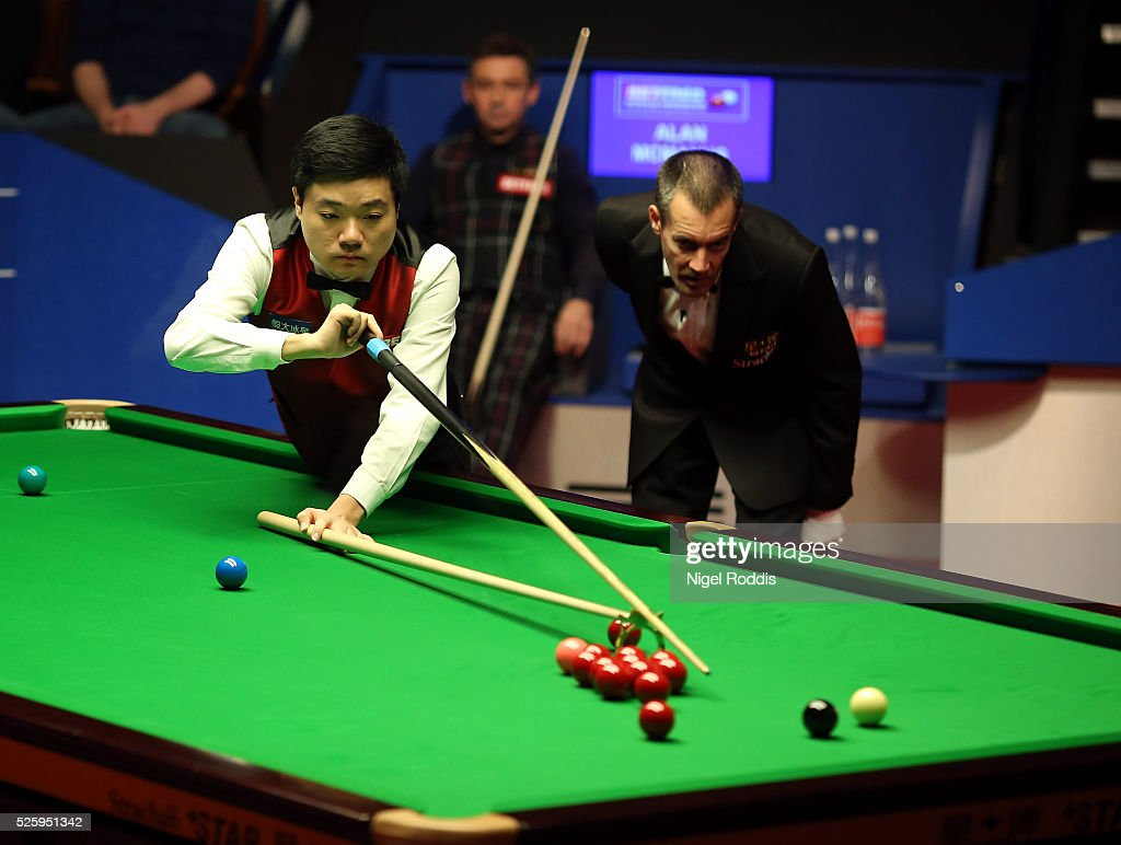 <a gi-track='captionPersonalityLinkClicked' href=/galleries/search?phrase=Ding+Junhui&family=editorial&specificpeople=214712 ng-click='$event.stopPropagation()'>Ding Junhui</a> of China during his semi final match against <a gi-track='captionPersonalityLinkClicked' href=/galleries/search?phrase=Alan+McManus&family=editorial&specificpeople=228666 ng-click='$event.stopPropagation()'>Alan McManus</a> of Scotland on day fourteen of the World Championship Snooker at Crucible Theatre on April 29, 2016 in Sheffield, England.