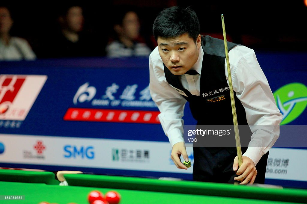 Ding Junhui of China eyes the ball in the match against Shaun Murphy of England on day four of the 2013 World Snooker Shanghai Master at Shanghai Grand Stage on September 19, 2013 in Shanghai, China.