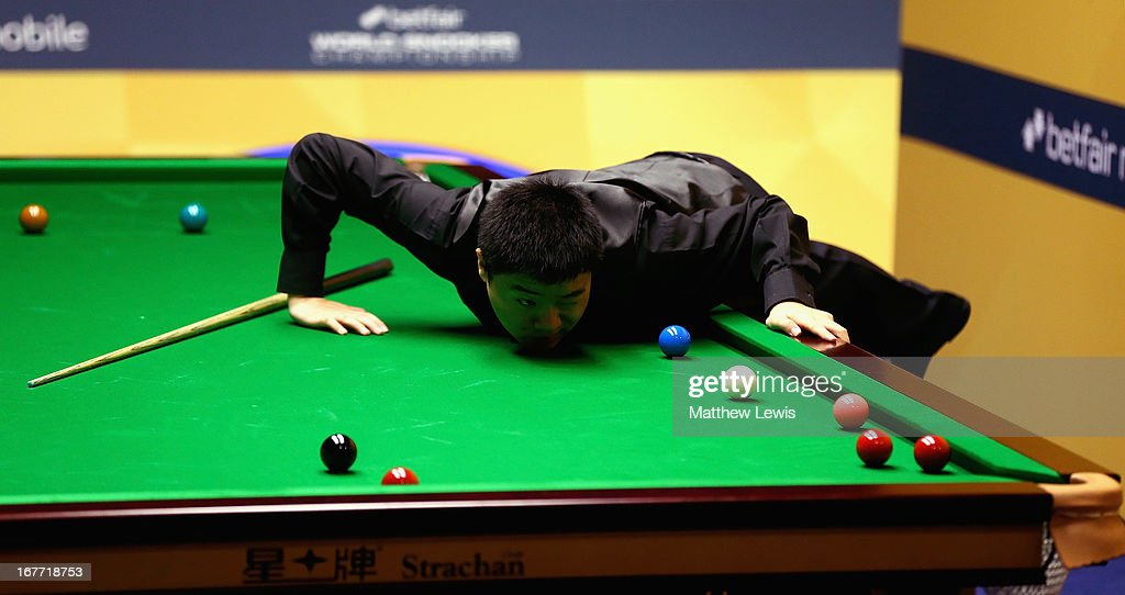 Ding Junhui of China in action against Mark King of England during second round match of the Betfair World Snooker Championship at the Crucible...