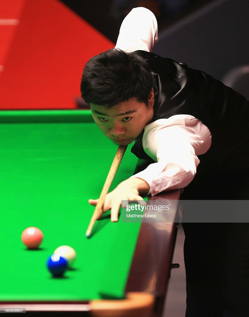 Ding Junhui of China in action against Michael Walsey of England during day four of the The Dafabet World Snooker Championship at Crucible Theatre on...