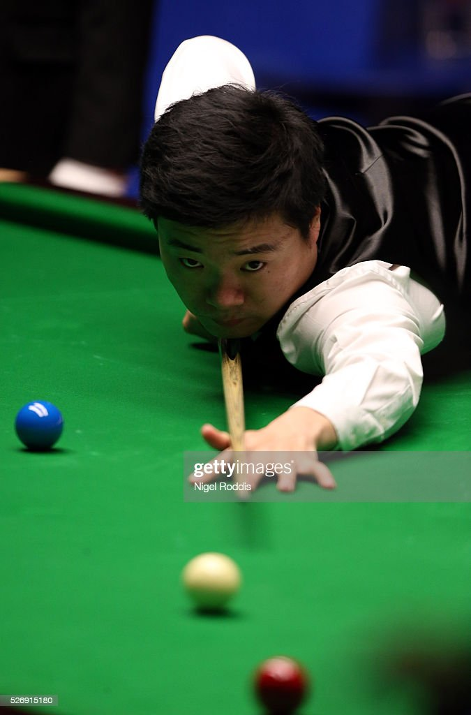 Ding Junhui of China in action during his final match against Mark Selby of England on day sixteen of the World Championship Snooker at Crucible Theatre on May 01, 2016 in Sheffield, England.