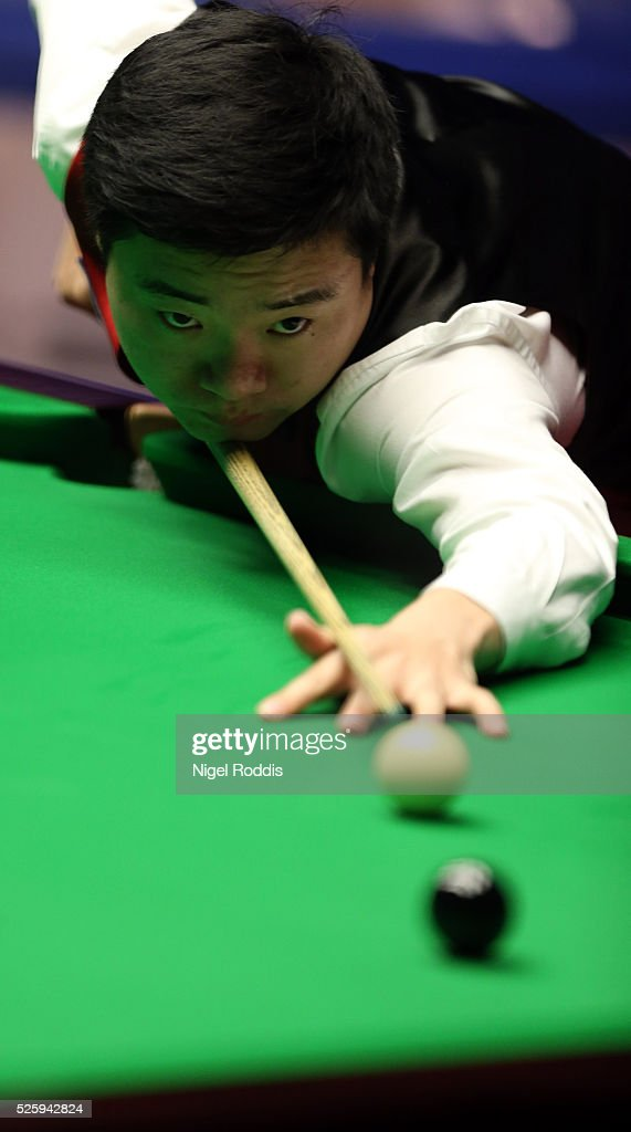 <a gi-track='captionPersonalityLinkClicked' href=/galleries/search?phrase=Ding+Junhui&family=editorial&specificpeople=214712 ng-click='$event.stopPropagation()'>Ding Junhui</a> of China in action during his semi final match against <a gi-track='captionPersonalityLinkClicked' href=/galleries/search?phrase=Alan+McManus&family=editorial&specificpeople=228666 ng-click='$event.stopPropagation()'>Alan McManus</a> of Scotland on day fourteen of the World Championship Snooker at Crucible Theatre on April 29, 2016 in Sheffield, England.