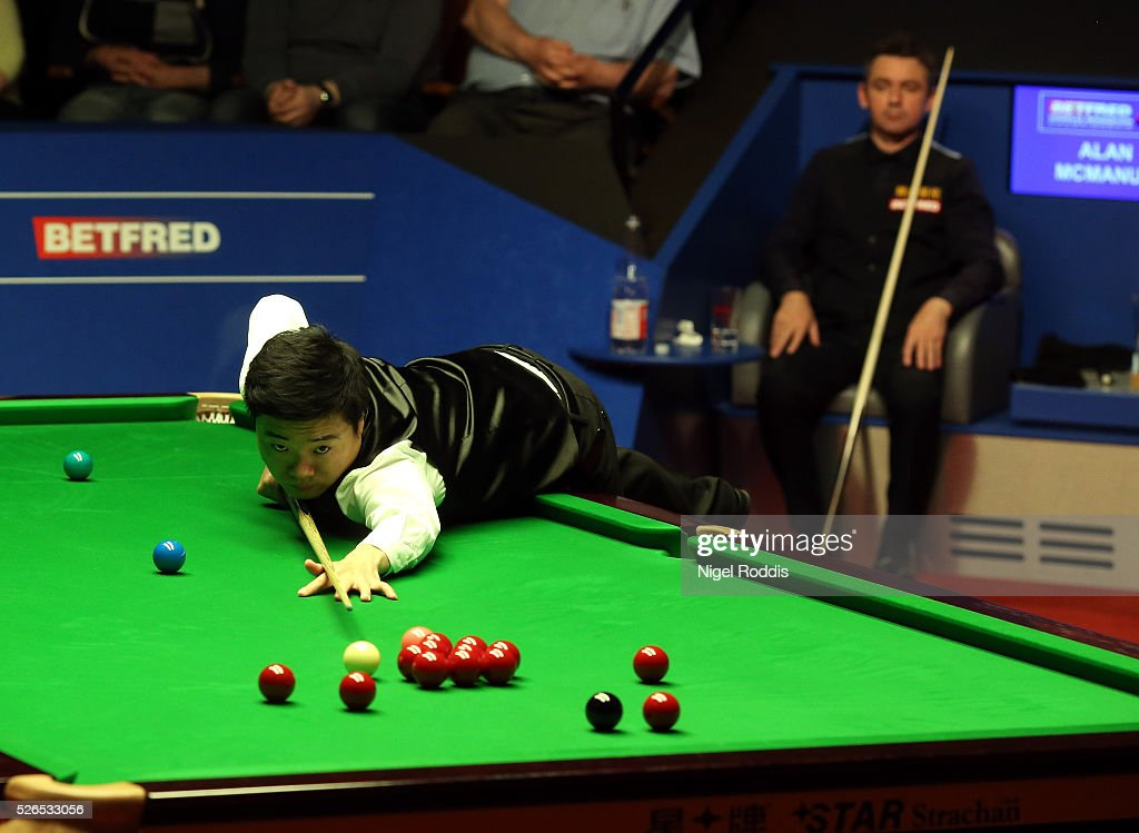 Ding Junhui of China in action during his semi final match against Alan McManus of Scotland on day fourteen of the World Championship Snooker at Crucible Theatre on April 30, 2016 in Sheffield, England.