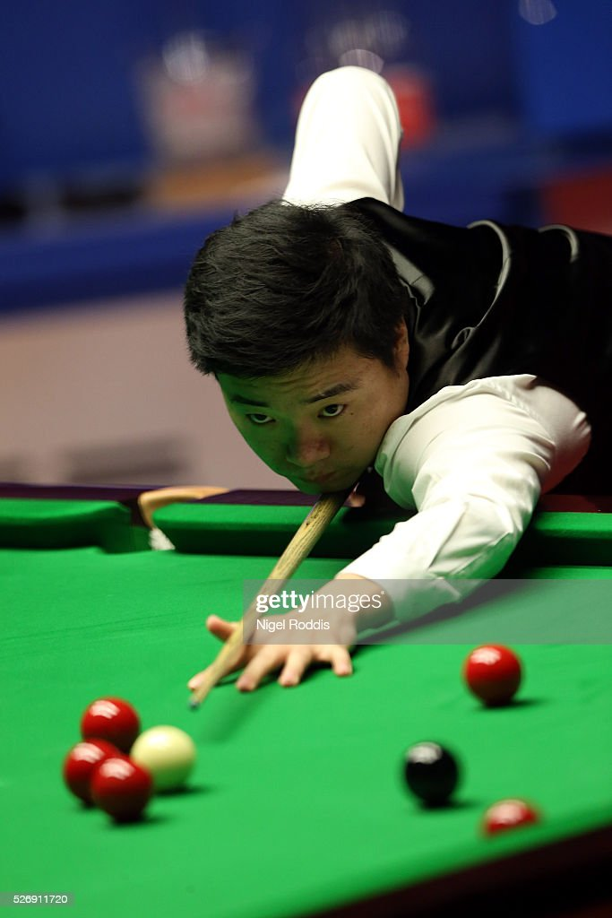<a gi-track='captionPersonalityLinkClicked' href=/galleries/search?phrase=Ding+Junhui&family=editorial&specificpeople=214712 ng-click='$event.stopPropagation()'>Ding Junhui</a> of China in action during the final against <a gi-track='captionPersonalityLinkClicked' href=/galleries/search?phrase=Mark+Selby&family=editorial&specificpeople=676444 ng-click='$event.stopPropagation()'>Mark Selby</a> of England on day sixteen of the World Championship Snooker at Crucible Theatre on May 01, 2016 in Sheffield, England.