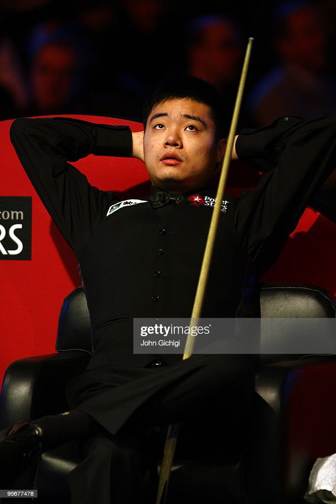 Ding Junhui of China looks dejected during his match against Mark Selby of England in the PokerStarscom Masters Snooker tournament at Wembley Arena...