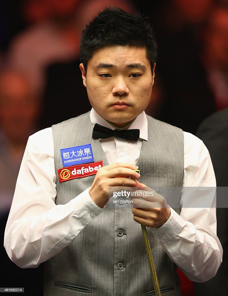 Ding Junhui of China looks on during his first round match against Joe Perry of England on Day Four of the 2015 Dafabet Masters at Alexandra Palace...