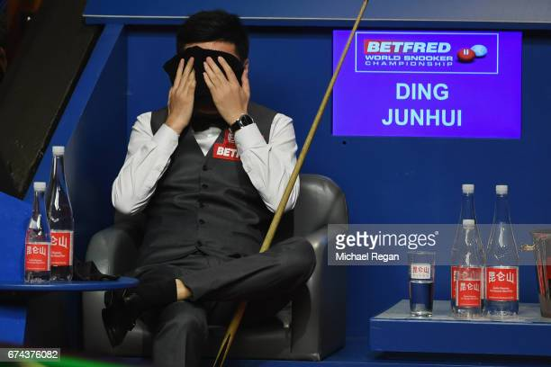 Ding Junhui of China looks on during his semifinal match against Mark Selby on day 14 of the World Snooker Championship at the Crucible Theatre on...