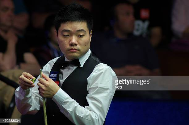 Ding Junhui of China looks on in his match against Mark Davies of England during day four of the 2015 Betfred World Snooker Championship at Crucible...