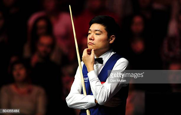 Ding Junhui of China looks on whilst playing against Stuart Bingham of England during Day One of the Dafabet Masters at Alexandra Palace on January...