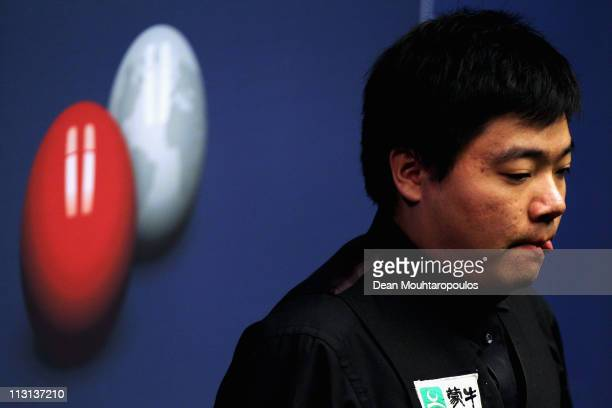 Ding Junhui of China looks to play a shot in the round two game against Stuart Bingham on day nine of the Betfredcom World Snooker Championship at...