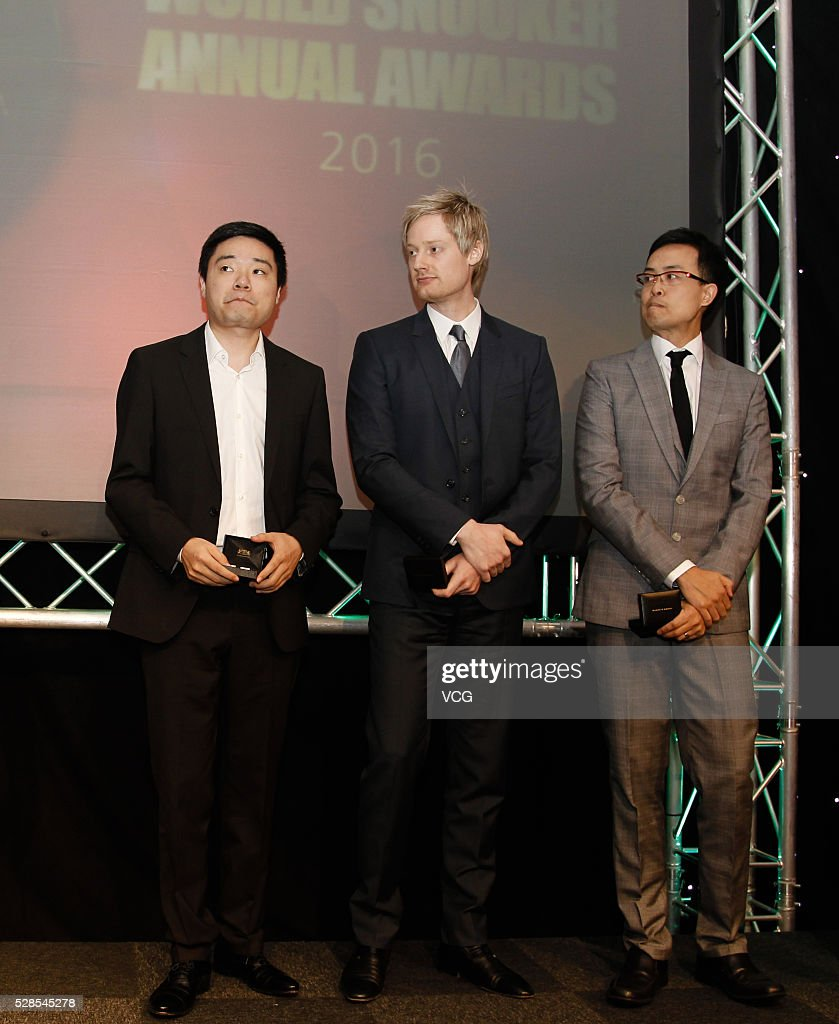 Ding Junhui of China, Neil Robertson of Australia and Marco Fu of Chinese Hong Kong, attend their annual end-of-season awards dinner on May 6, 2016 in Manchester, England.