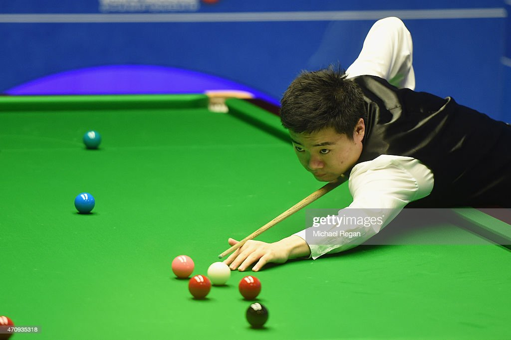Ding Junhui of China plays a shot against John Higgins of Scotland during day seven of the 2015 Betfred World Snooker Championship at Crucible...