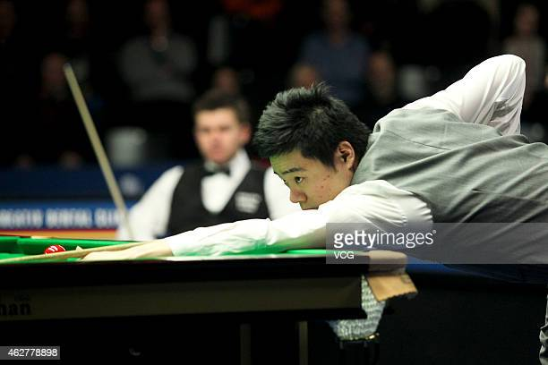 Ding Junhui of China plays a shot against Ryan Day of UK on day two of the 2015 German Masters at Tempodrom on February 5 2015 in Berlin Germany