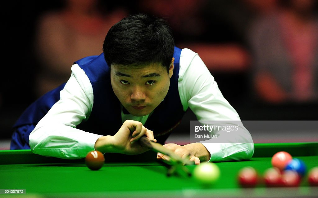 Ding Junhui of China plays a shot against Stuart Bingham of England during Day One of the Dafabet Masters at Alexandra Palace on January 10 2016 in...