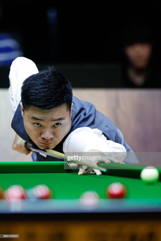 Ding Junhui of China plays a shot during a qualifying match against Niu Zhuang of China on day one of Evergrande 2017 World Snooker China Champion at Guangzhou Sport University on August 16, 2017 in Guangzhou, Guangdong Province of China.